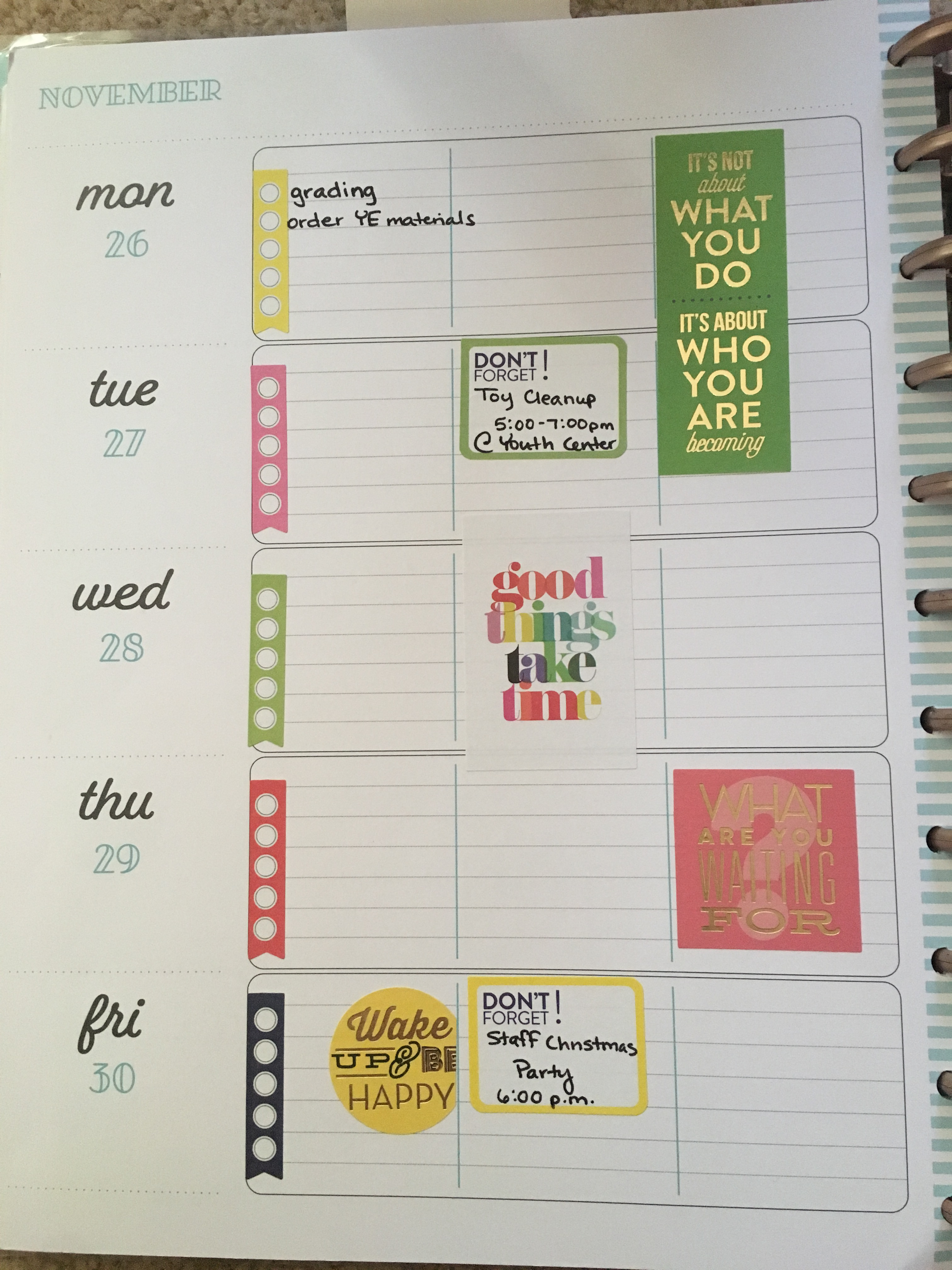 Happy Planner spread for the week of November 26th with quote stickers and to-do lists.